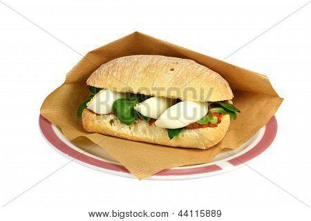 Roll filet americain filet sandwich.