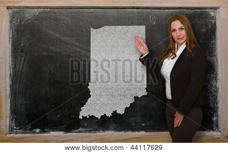Teacher Showing Map Of Indiana On Blackboard