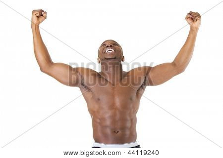 Well-built muscular black man with arms raised , isolated on white