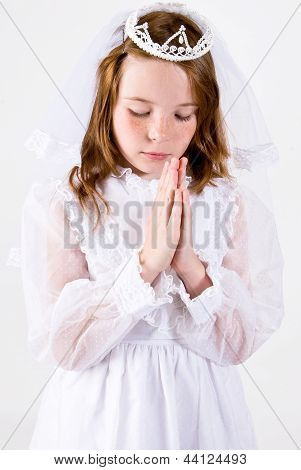 Young girl Praying in First Communion Attire