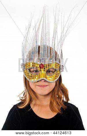 Young Caucasian female child wearing a fancy mask