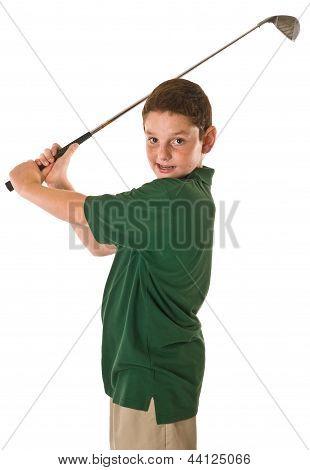 Young boy swinging a golf club