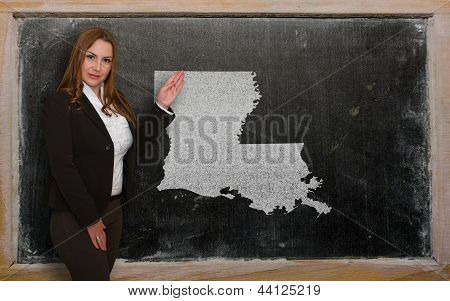 Teacher Showing Map Of Louisiana On Blackboard