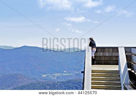 Boy On Tower In Mountains