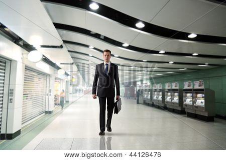 business man walking in subway