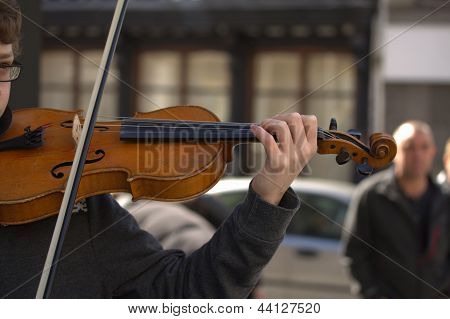 Young musician busking