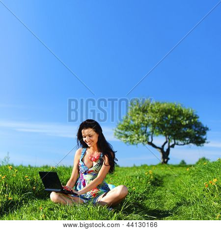 laptop work in green grass field