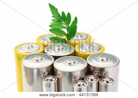 Alkaline Batteries Symbol Of Clean Energy And Green Leaf On A White Background.