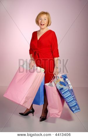 Attractive Older Lady Holding Shopping Bags