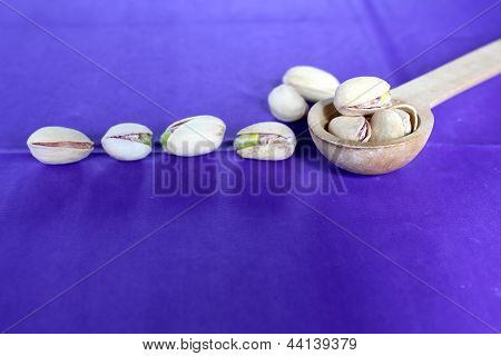 Salted pistachios on purple