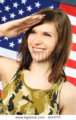 Cheerful Woman Dressed In Camouflage Salutes