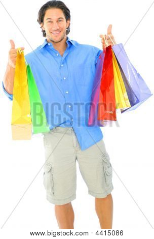 Happy Young Man Carrying Shopping Bag