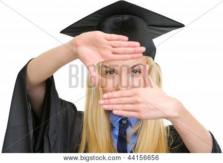 Young Woman In Graduation Gown Framing With Hands