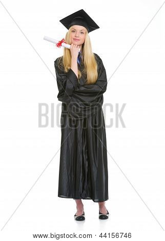 Full Length Portrait Of Young Woman In Graduation Gown With Diploma