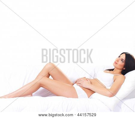 Schwangere Frau mit den schönen Bauch, isolated on white background