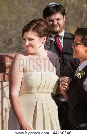 Cheerful Bride With Partner