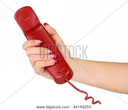 Female hand with rotary telephone handset, isolated on white