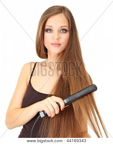Woman doing hairstyle with hair straightener, isolated on white
