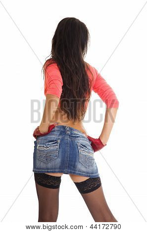 Sexy Woman In Jeans Mini Skirt And Stockings