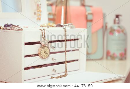 Jewelry With Vintage Clock And Female Complements In Soft Pastel Colors