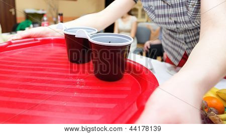 Woman Holding A Tray With Disposable Coffee Cups