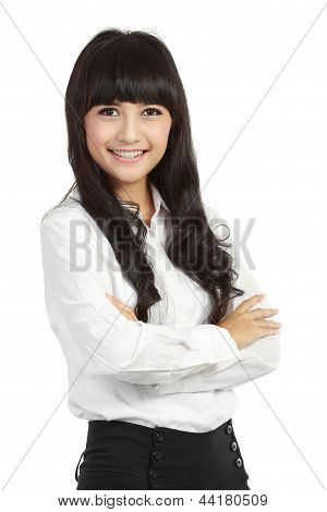 Portrait Of A Happy Young Business Woman Standing With Folded Hand