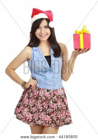 Teen Girl In Santa Hat Presenting Gift