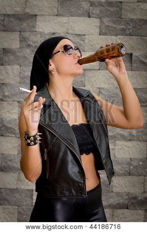 Woman having a beer drink and a smoke.