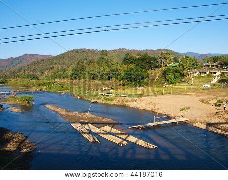 Bamboo Rafts In Pai River Viewed From Memorial Bridge In Pai, Mae Hong Son, Thailand