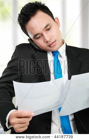 Businessman Holding A Report
