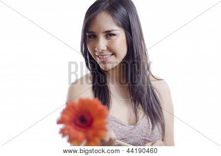 Cute woman giving a flower away