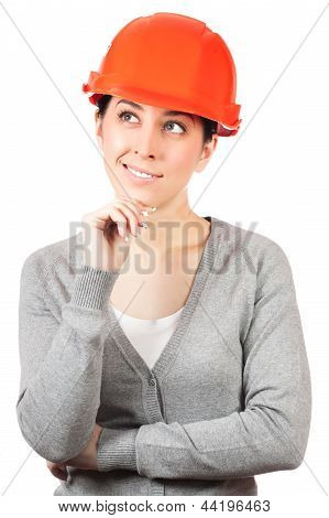 Young woman with orange hard hat on white
