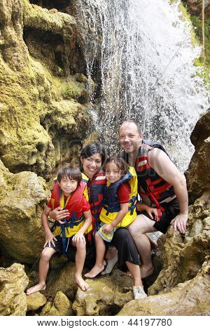 Happy Family In The Waterfall
