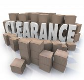 The word Clearance surrounded by cardboard boxes and packages in a storeroom or stockroom, an overst