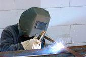 stock photo of welding  - welder worker welding metal - JPG