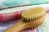 stock photo of bristle brush  - Wooden light brown brush with the long handle for body massage - JPG