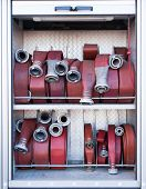 stock photo of firehose  - Firehoses in a truck to be used by firefighters - JPG
