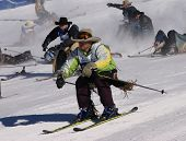 Cowboy Stampede - Mass Start Of Skiing Cowboys Race Downhill,