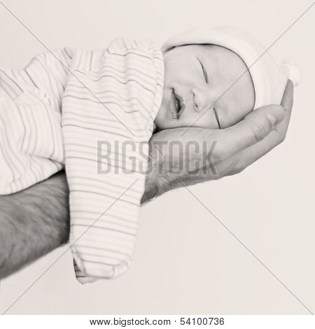 Cute Newborn Baby Sleeps Smiling
