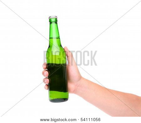 A hand holding up a green beer bottle