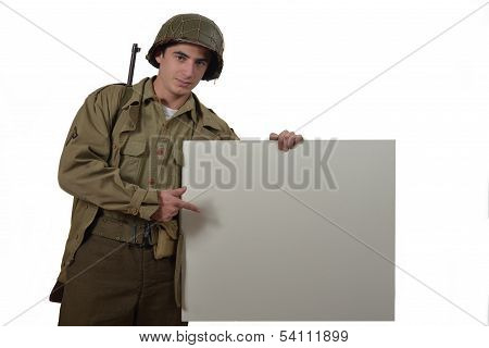 Young American Soldier Shows A Sign