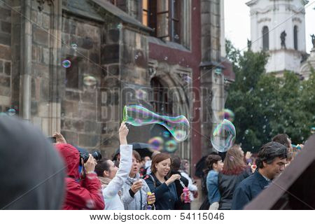 Girls Playing With Soap Bubbles In The Street.