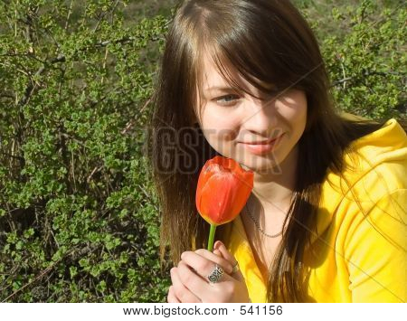 The Girl Smells A Flower