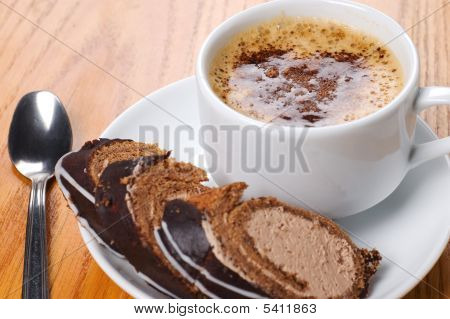 Close-up Cup Of Coffee With Dessert