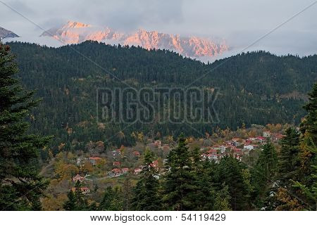 Village And Mountain At Late Afternoon