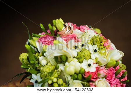 Two Wedding Rings On Bridal Bouquet