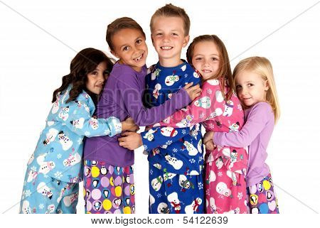 Children Hugging In Holiday Christmas Pajamas