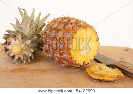 Ripe Pineapple On Cutting Board
