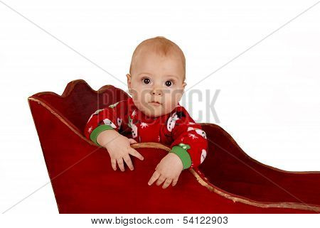Toddler Boy In Snowman Pajamas In A Sleigh