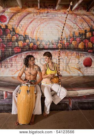 Capoeira Couple Playing Music